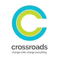 "Crossroads Logo with tagline ""Change a life. Change everything."""