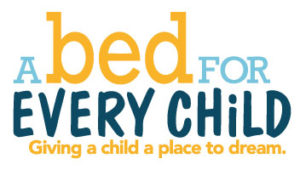 "A Bed For Every Child logo with tagline ""Giving a child a place to dream."""